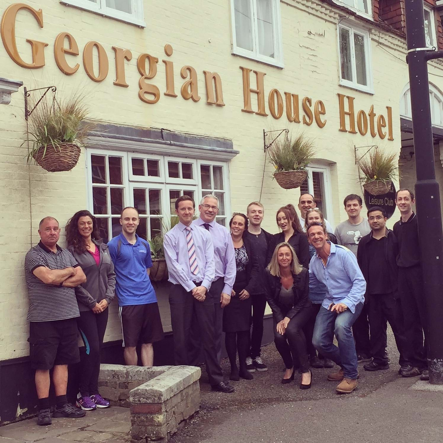 Sarah and Mark McVeigh with the team outside the Georgian House Hotel