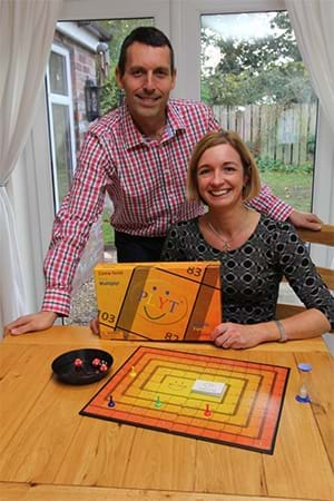 Ian McCartney and Lisa McCartney with the board game PLYT